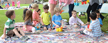 Kids outdoors on a blanket